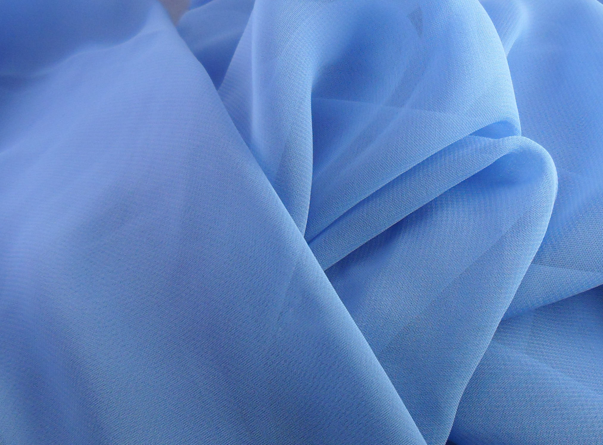 sheer blue fabric with rolled hem edges thumbnail 3