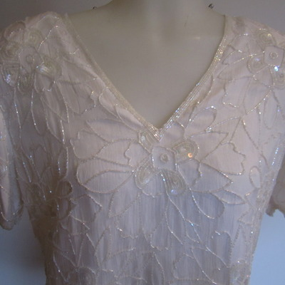 White beaded blouse