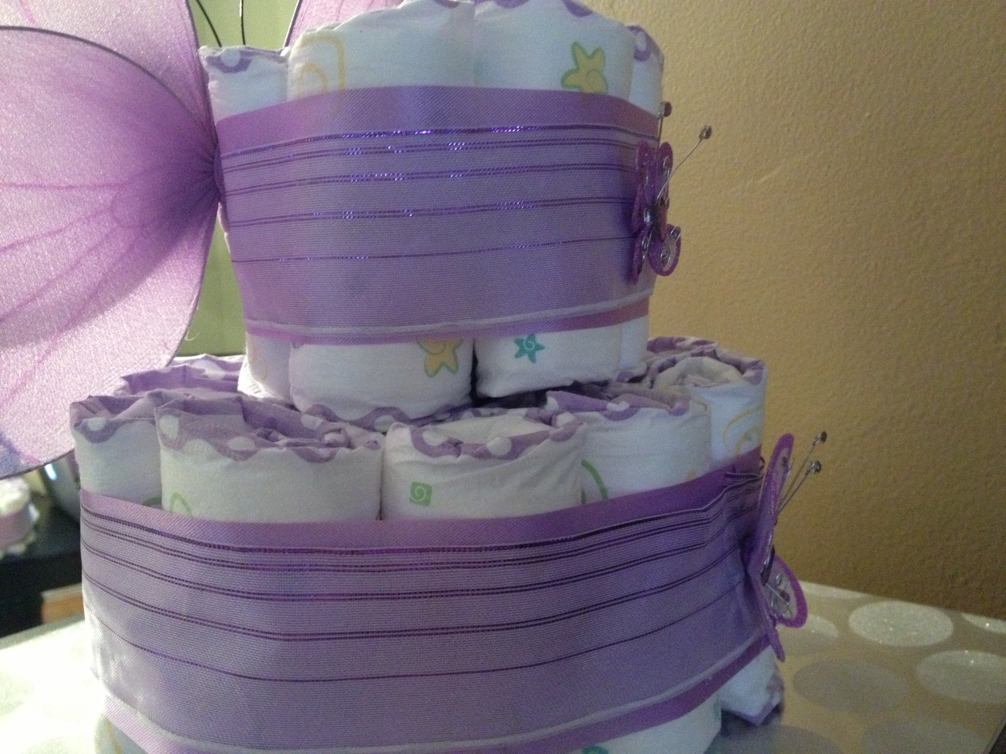 2 tier purple butterfly diaper cake from Baby Dreams on Storenvy