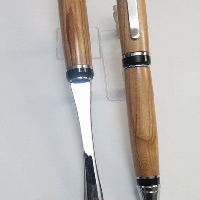 Cigar style, chrome twist pen,cherry, and letter opener set