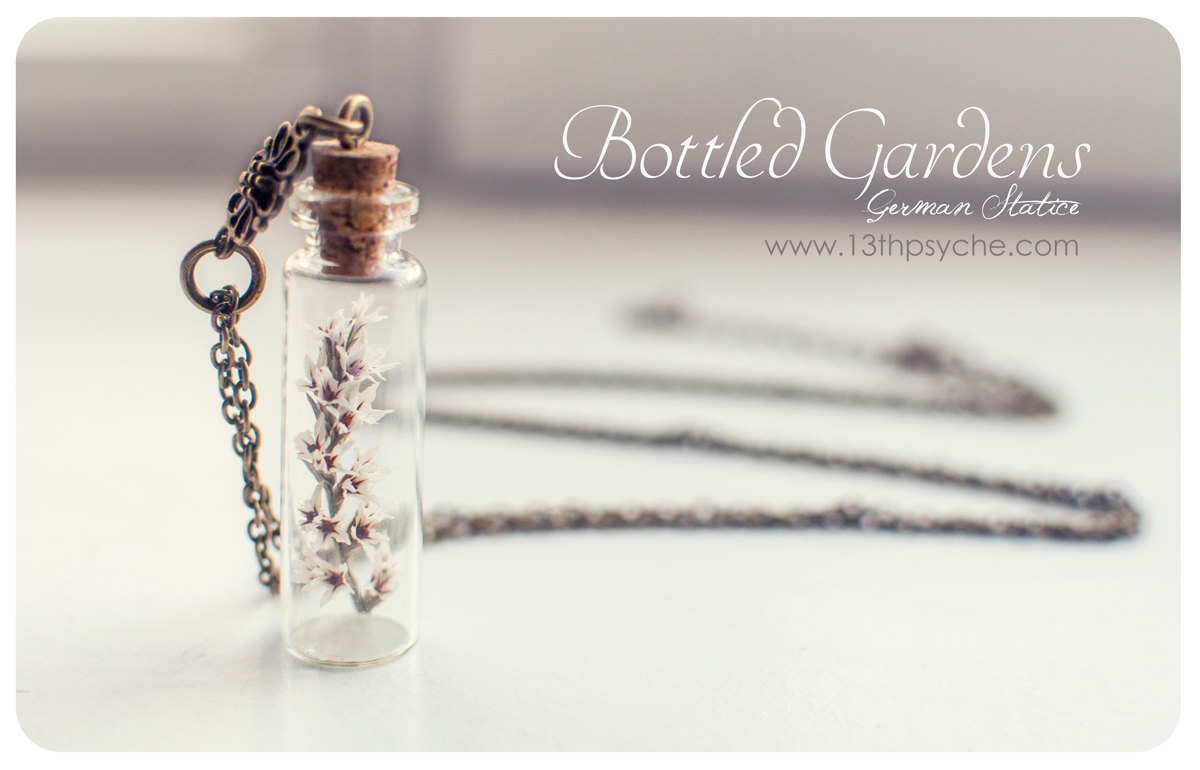 Tiny white flower bottle necklaceass bottle pendantte necklace tiny white flower bottle necklaceass bottle pendantte necklaceonze necklace miniature mozeypictures Choice Image