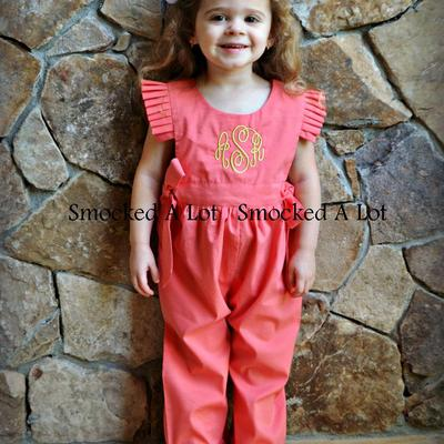 Coral side-tie ruffled romper with gold metallic monogram