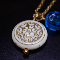 Carved Atlantic Coin and Blue Lucite Necklace