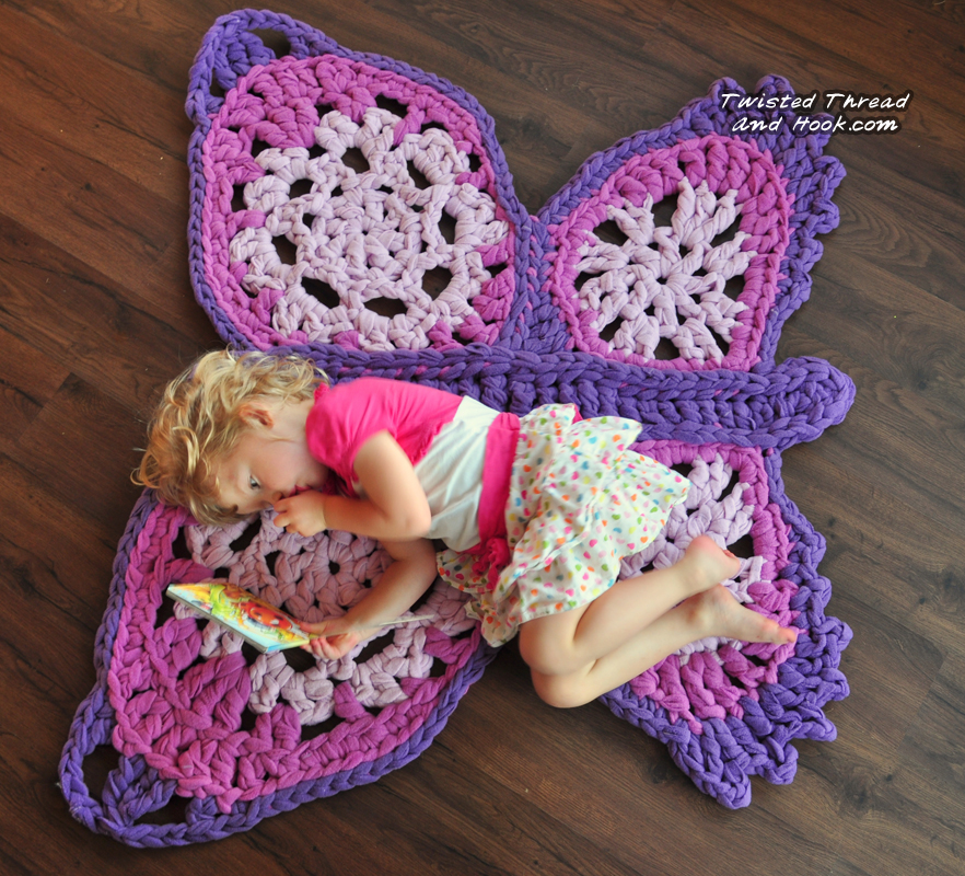 http://twistedthreadandhook.storenvy.com/products/2425533-purple-butterfly-rug-handmade-for-children-room-decor-or-girl-nursery
