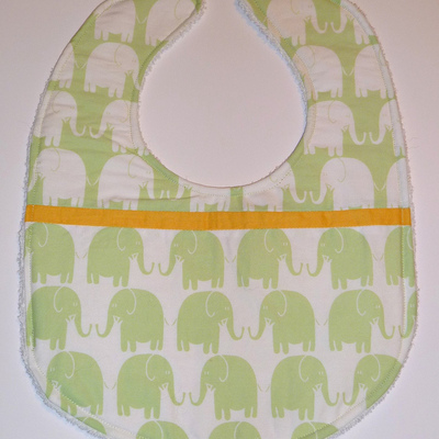 Baby bib (light green, white and yellow fabric, terry cloth back)