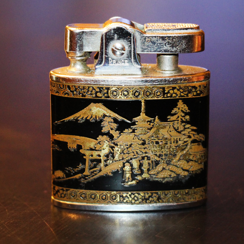 Vintage 1950 s prince automatic super lighter showing a traditional