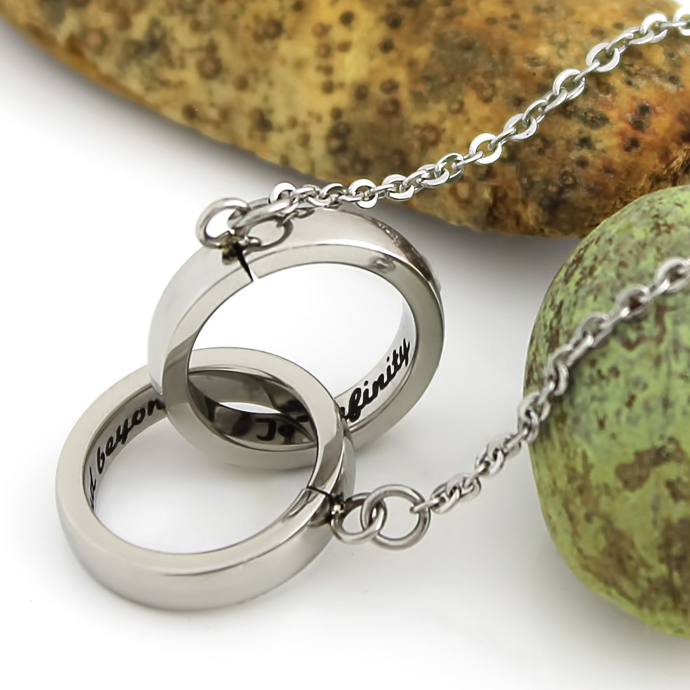 Tzaro jewelry infinity necklace to infinity and beyond for Infinity ring jewelry store
