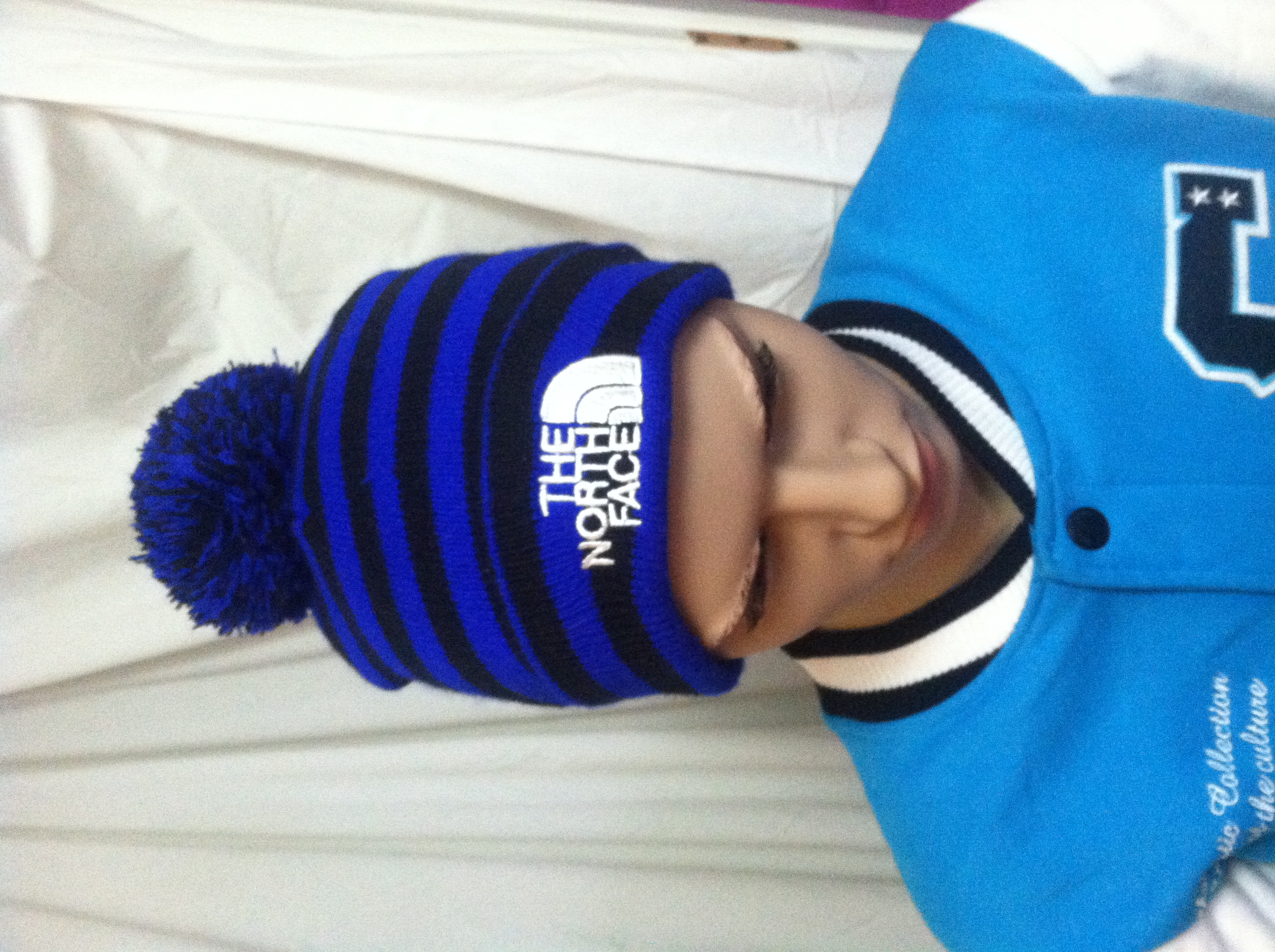9f0af640016 Men s Royal Blue and Black Striped The North Face Winter Hat Beanie with  Pom Pom