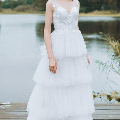 c1efd30e391 Sheer v-neckline lace bride wedding dress with tiered tulle skirt